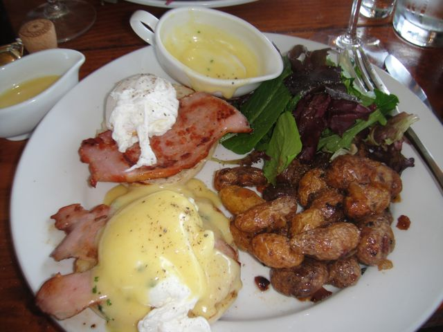 Classic Eggs Benedict with Canadian Bacon, breakfast potatoes, mixed ...