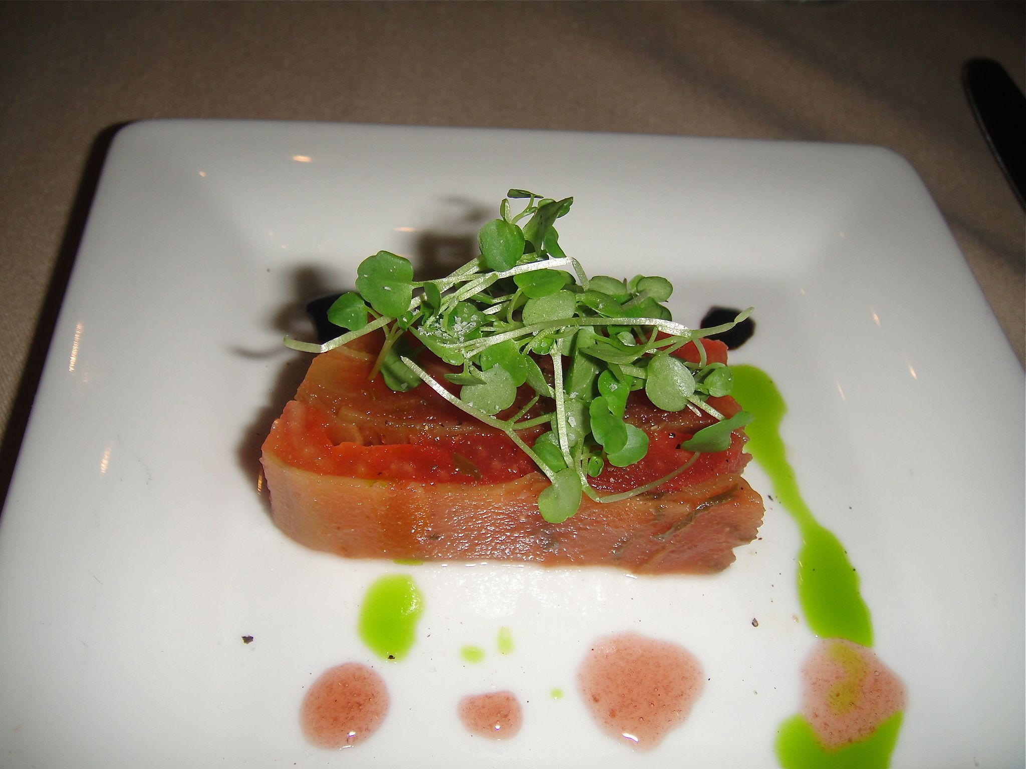 Eggplant and tomato terrine with basil and microgreens, dots of aged ...
